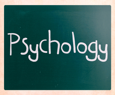 The word Psychology handwritten with white chalk on a blackboard photo