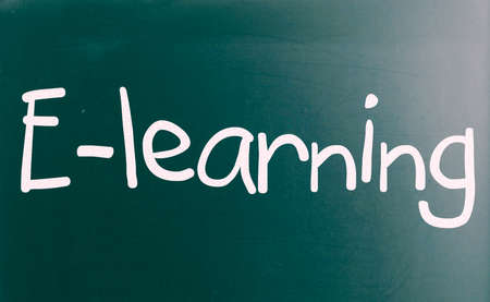 The word E-learning handwritten with white chalk on a blackboard