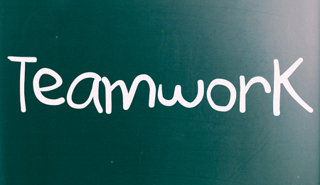 combined effort: The word Teamwork handwritten with white chalk on a blackboard