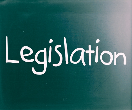 The word Legislation handwritten with white chalk on a blackboard photo