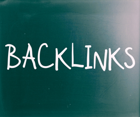 The word 'Backlinks' handwritten with white chalk on a blackboard photo