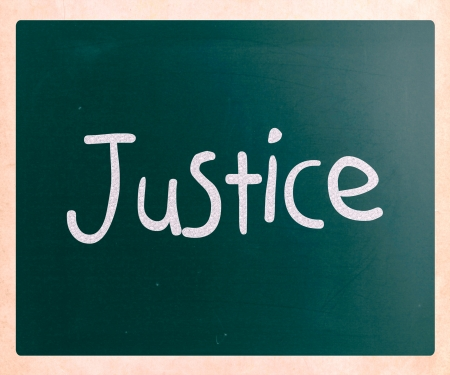 rightness: Justice handwritten with white chalk on a blackboard