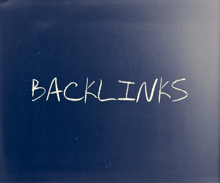 The word 'Backlinks' handwritten with white chalk on a blackboard. photo