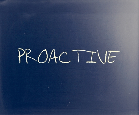 proactive: The word Proactive handwritten with white chalk on a blackboard.