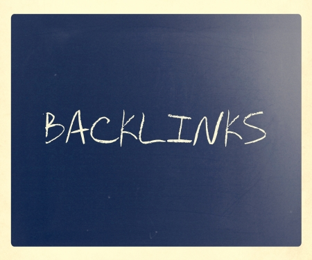 The word Backlinks handwritten with white chalk on a blackboard.