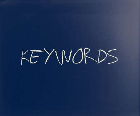 'Keywords' handwritten with white chalk on a blackboard. photo