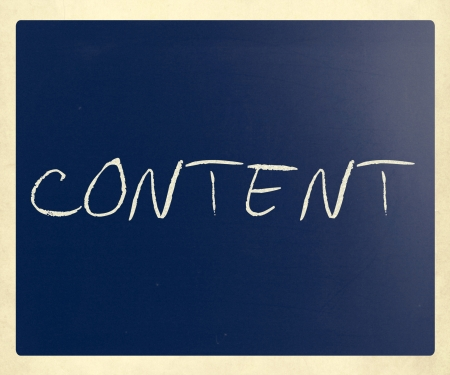 The word 'Content' handwritten with white chalk on a blackboard. photo