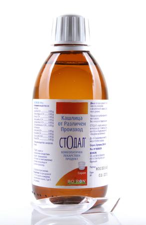 AYTOS, BULGARIA - JANUARY 28, 2014: Liquid medicine in glass bottle - Stodal.