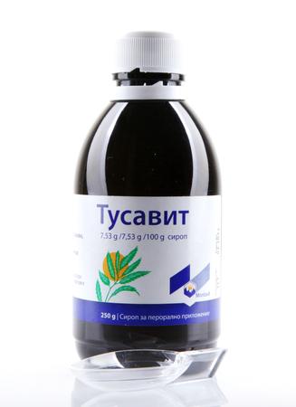 AYTOS, BULGARIA - JANUARY 28, 2014: Liquid medicine in glass bottle - Tusavit.