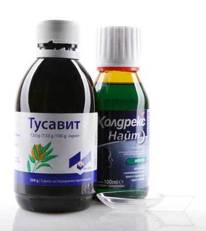nite: AYTOS, BULGARIA - JANUARY 28, 2014: Liquid medicine in glass bottle - Tusavit, Coldrex Nite. Editorial