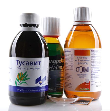 nite: AYTOS, BULGARIA - JANUARY 28, 2014: Liquid medicine in glass bottle - Tusavit, Coldrex Nite, Stodal.