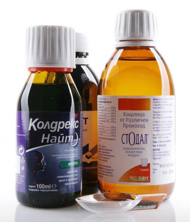 AYTOS, BULGARIA - JANUARY 28, 2014: Liquid medicine in glass bottle - Tusavit, Coldrex Nite, Stodal.