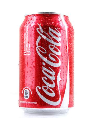 AYTOS, BULGARIA - MARCH 14, 2014: Coca-Cola isolated on white background. Coca-Cola is a carbonated soft drink sold in stores, restaurants, and vending machines throughout the world.