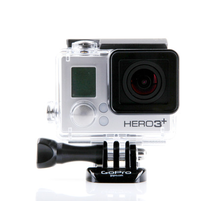 cam gear: AYTOS, BULGARIA - MARCH 15, 2014: GoPro HERO3  Black Edition isolated on white background. GoPro is a brand of high-definition personal cameras, often used in extreme action video photography.