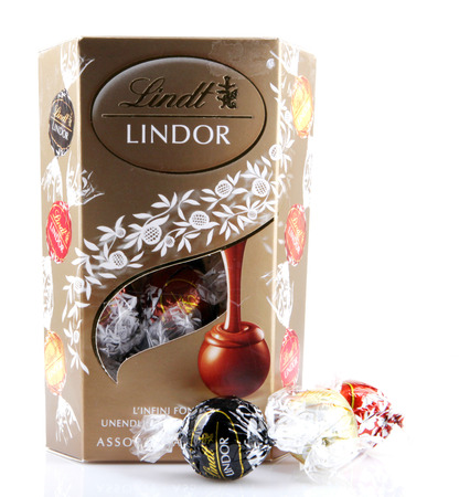 AYTOS, BULGARIA - APRIL 02, 2014: Milk Chocolate LINDOR truffle. Lindt & Sprüngli is recognized as a leader in the market for premium quality chocolate.