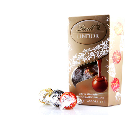 lindt: AYTOS, BULGARIA - APRIL 02, 2014: Milk Chocolate LINDOR truffle. Lindt & Sprüngli is recognized as a leader in the market for premium quality chocolate.