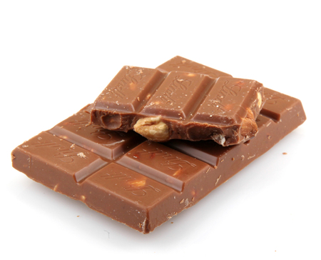 lindt: AYTOS, BULGARIA - MAY 05, 2014: Lindt Swiss milk chocolate with whole hazelnuts. Lindt is recognized as a leader in the market for premium quality chocolate. Editorial