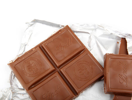 lindt: AYTOS, BULGARIA - MAY 10, 2014: Lindt Swiss milk chocolate. Lindt is recognized as a leader in the market for premium quality chocolate. Editorial