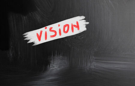 vision handwritten with chalk on a blackboard photo