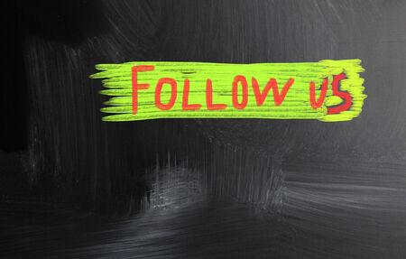 follow us handwritten with chalk on a blackboard photo
