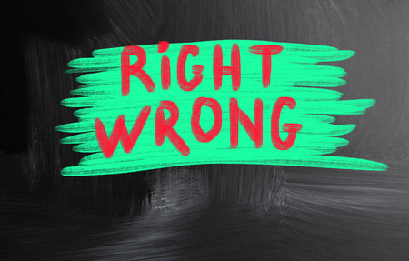 right wrong handwritten with chalk on a blackboard photo