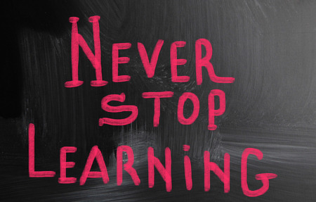 encapsulate: never stop learning handwritten with chalk on a blackboard Stock Photo