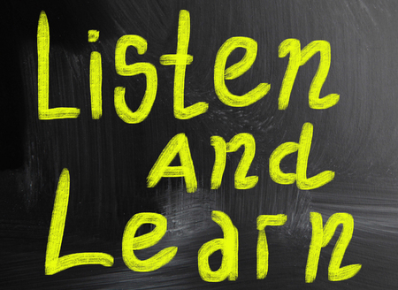 listen and learn handwritten with chalk on a blackboard photo