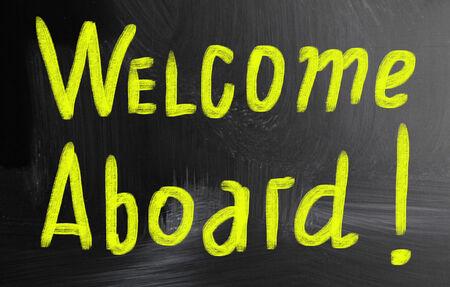 aboard: welcome aboard handwritten with chalk on a blackboard