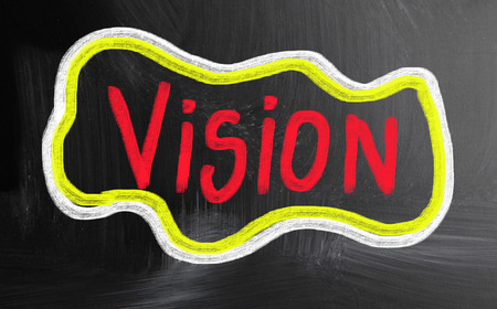 our vision: vision handwritten with chalk on a blackboard