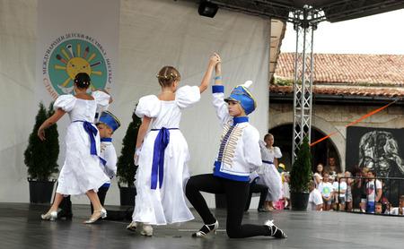 "patronage: NESSEBAR - JUNE 18: ""Sun, Joy, Beauty"" 15th International Children's Festival on June 18, 2014 in Nessebar, Bulgaria. The festival is organized every year in the town of Nessebar under the patronage of the municipality. It starts on 15th June. Child Editorial"
