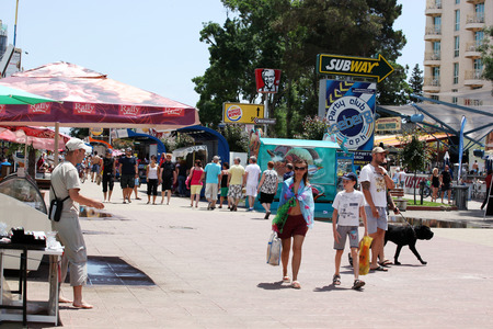 SUNNY BEACH, BULGARIA - JUNE 19: People visit  Sunny Beach on June 19, 2014. Sunny Beach is the largest and most popular seaside beach resort in Bulgaria.