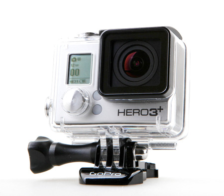 cam gear: AYTOS, BULGARIA - OCTOBER 15, 2014: GoPro HERO3+ Black Edition isolated on white background. GoPro is a brand of high-definition personal cameras, often used in extreme action video photography.