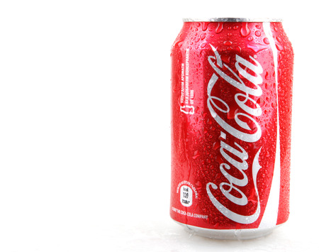 AYTOS, BULGARIA - DECEMBER 11, 2014: Coca-Cola isolated on white background. Coca-Cola is a carbonated soft drink sold in stores, restaurants, and vending machines throughout the world.