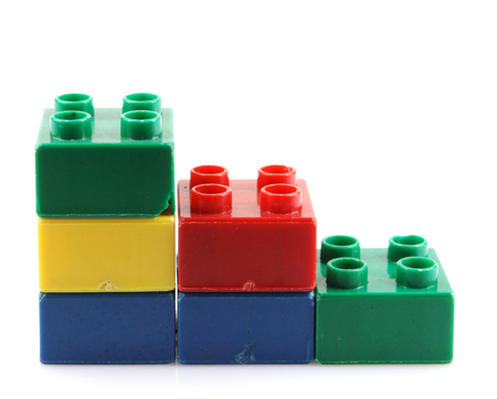 yellow lego block: plastic building blocks Stock Photo