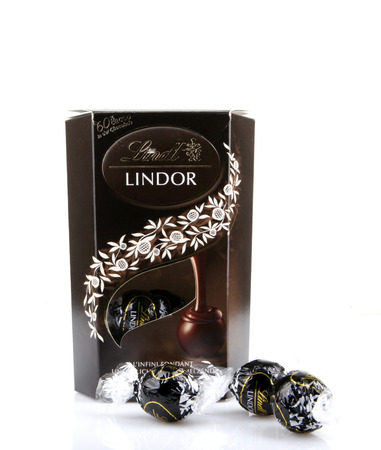 recognized: AYTOS, BULGARIA - APRIL 03, 2016: Milk Chocolate LINDOR truffle. Lindt is recognized as a leader in the market for premium quality chocolate.