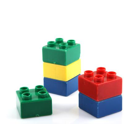 yellow lego block: plastic building blocks Stock Photo