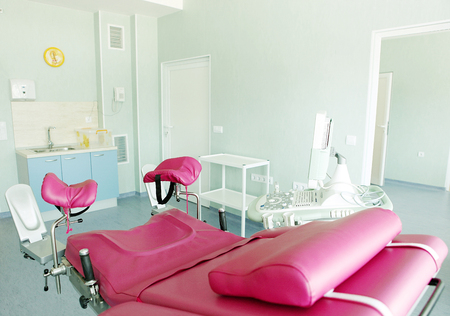 Gynecological chair in gynecological room. Stock Photo - 62263698