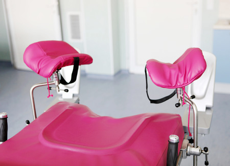 Gynecological chair in gynecological room. Stock Photo