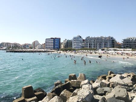 Pomorie, Bulgaria - September 18, 2017: People enjoying their time at Pomorie Beach, Bulgaria.