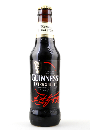 Pomorie, Bulgaria - October 27, 2017: Guinness Irish Wheat Beer. Guinness is an Irish dry stout that originated in the brewery of Arthur Guinness at St. Jamess Gate brewery in the capital city of Dublin, Ireland.