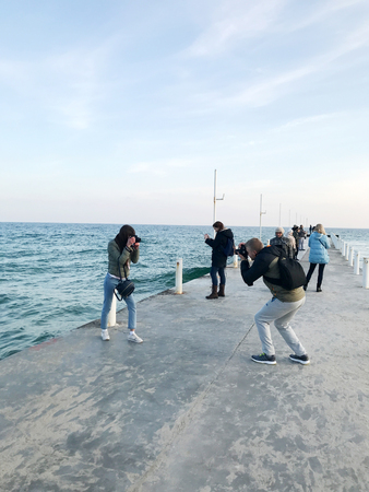 Odessa, Ukraine - November 17, 2017: People visit Arcadia beach. Arcadia beach is Odessa, Ukraines most famous beach. It is located in the Arcadia quarter. Editorial