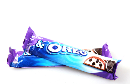 Pomorie, Bulgaria - December 09, 2017: Milka Oreo mini isolated on white background. Oreo is a sandwich cookie consisting of two chocolate disks with a sweet cream filling in between.