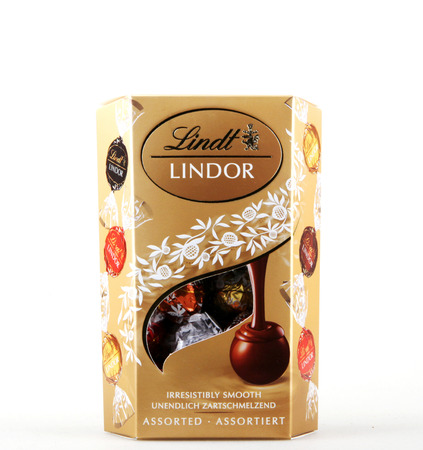 Pomorie, Bulgaria - January 09, 2018: A box of Lindt Lindor chocolate truffles. Chocoladefabriken Lindt & Sprüngli AG is a Swiss chocolatier and confectionery company founded in 1845 and known for its chocolate truffles and chocolate bars, among other sw