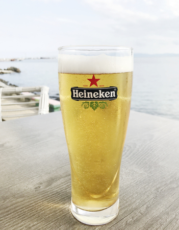 Pomorie, Bulgaria - May 19, 2018: Heineken Lager Beer produced by the Dutch brewing company. Heineken is well known for its signature green bottle and red star.