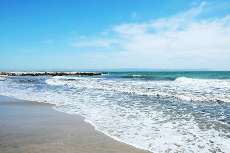 Beach and sea in bright sunlight Stock Photo