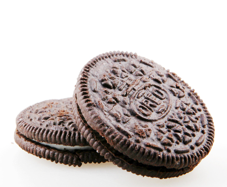 Pomorie, Bulgaria - May 28, 2018: Oreo isolated on white background. Oreo is a sandwich cookie consisting of two chocolate disks with a sweet cream filling in between. Editorial