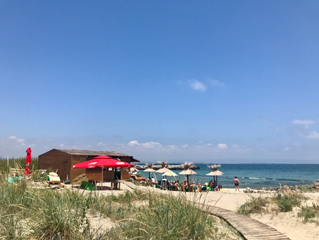 Pomorie, Bulgaria - June 05, 2018: View of the people spending time on the beach.