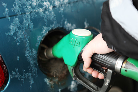 A car refueling at a gas station