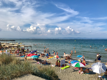 Pomorie, Bulgaria - August 28, 2018: People relaxing on the beach.
