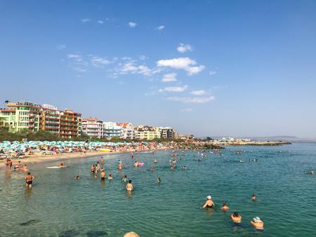 Pomorie, Bulgaria - September 03, 2018: People relaxing on the beach.